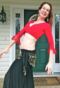 Prepping to teach a mini-class in belly dance fitness. This is to belly dance what rumba is to Latin dance. Pulls out discrete elements to build fitness, rather than teaching a strict form of dance as performance art.